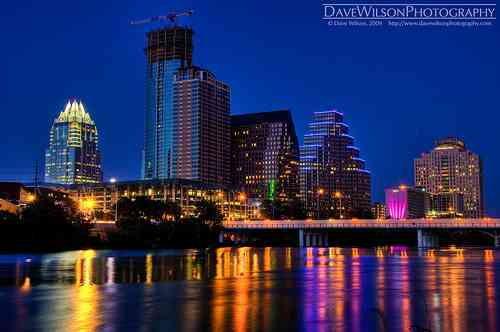 Austin Skyline at Dusk  A 3 exposure HDR taken around 9pm. I love the way the long exposure has blurred the surface of the water and the great colored streaks from the lights on the opposite bank.
