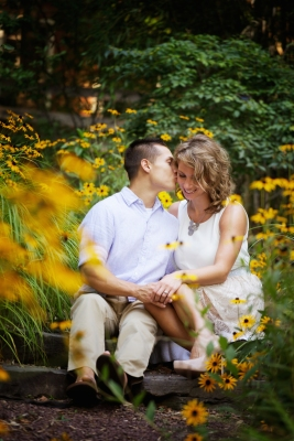 Framing this couple with flowers offers a romantic look. ©LovesomePhoto.com